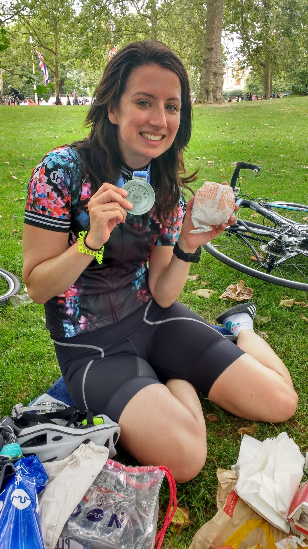 Me, with inevitable sausage-leg eating a cheeseburger post-Ride London 46. Best kit photo ever?